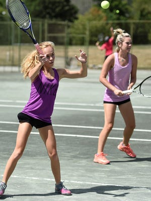 Former Lexington star Elise Betscher hits a return en route to winning women's doubles with college roommate Audrey Rang in Sunday's action at the 83rd News Journal/Richland Bank Tennis Tournament, held at Lakewood Racquet Club.