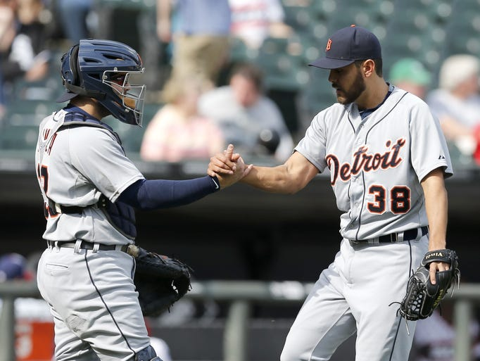Detroit Tigers catcher Alex Avila, left, and Joakim