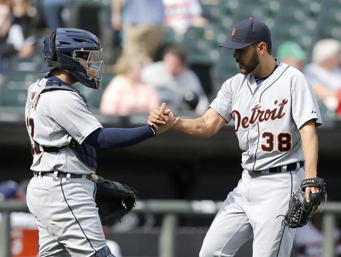 Detroit Tigers catcher Alex Avila, left, and Joakim
