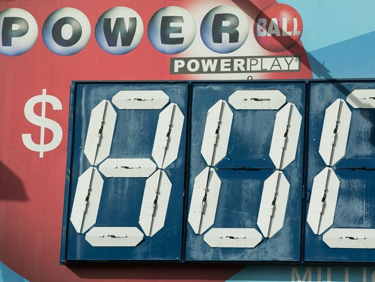 The estimated Powerball jackpot posted along El Paseo