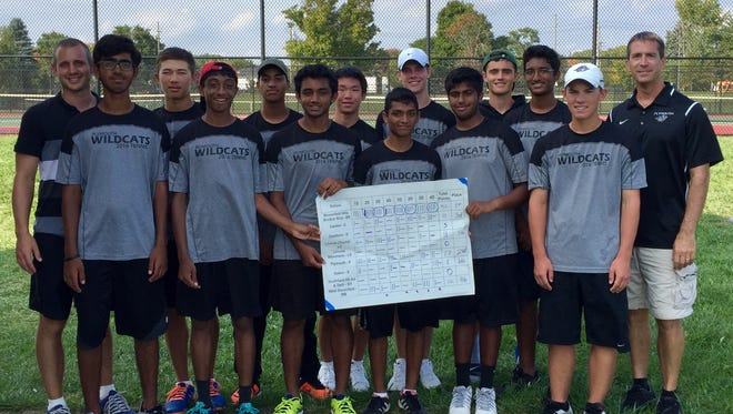 Plymouth's varsity boys tennis team proudly poses after finishing second at Thursday's D1 regional. The team will compete Oct. 14 in the finals, the first time that has happened in school history.