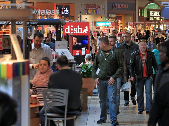 Shoppers move through Castleton Square Mall in search of deals.
