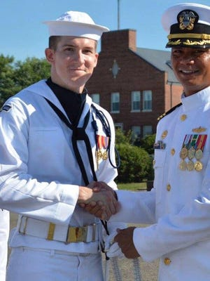 Robert Volski, left, a 2008 Ida Baker High School graduate from Cape Coral, poses in his Navy uniform with Commanding Officer, Cmdr. Ronel Reyes, US Navy Ceremonial Guard. Volski marched as part of President Donald Trump's inauguration parade.