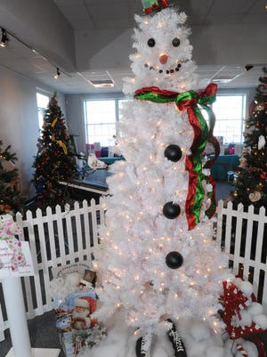 A white tree from Roen Salvage Co. was made to resemble a snowman for last year's Merry-Time Festival of Trees at the Door County Maritime Museum.