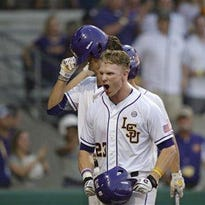 LSU's Jake Fraley (23) celebrates after a home run.