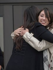 Michelle Susan Hadley (right) hugs Orange County District Attorney Chief of Staff Susan Kang Schroeder after being cleared of all charges in a complicated plot to frame her in Fullerton, Calif., on Jan. 9, 2017. Her mother, Suzanne Hadley, is at left.