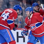 Montreal Canadiens forward Torrey Mitchell (17) celebrates