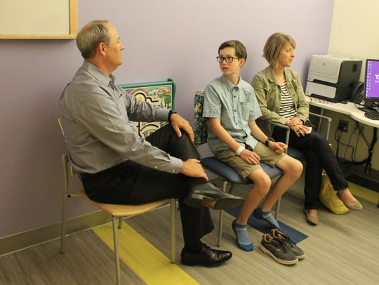 Jim Colbert, left, Noah and Libby came to Colorado Children's Hospital for Noah's regular check-up Wednesday. The Fort Collins family makes the trek at least quarterly to help manage Noah's cystic fibrosis.