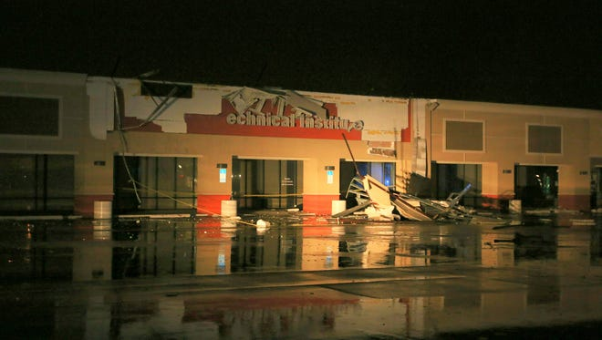 Storm damage to ITT Technical Institute in the Eastgate Plaza at Ninth Avenue and Creighton Road. Police said the damage was indicative of a tornado.
