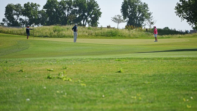 Tom Jansa, president of Dakota Golf, visits with golfers on Elmwood Golf Course's 15th hole Wednesday, June 14, 2017, in Sioux Falls.