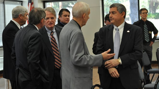 State Commissioner of Administration Jay Dardenne (right) chats after speaking Thursday at the Central Louisiana Chamber of Commerce's February Strategic Luncheon.