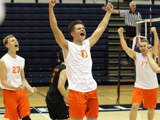 Northeastern's Matt Schaeffer (10) reacts along with the rest of the team after they swept Saegertown 3-0 to win the PIAA Class AA boys' volleyball championship at Penn State's Rec Hall.