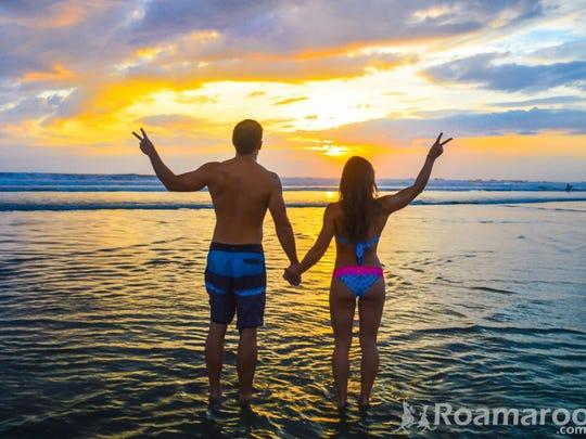 Collette and Scott Stohler enjoy a sunset in Nosara, Costa Rica
