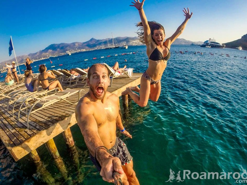 Collette and Scott jump into the water in Bodrum, Turkey.