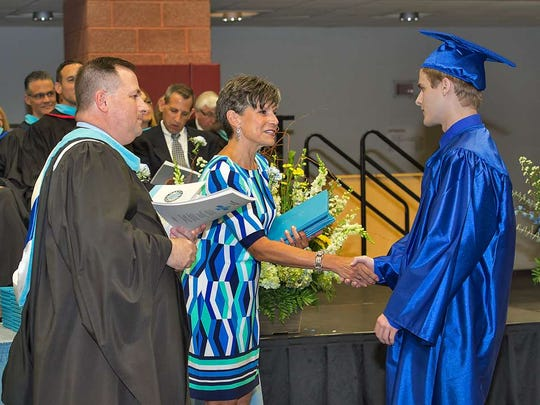Mahwah High School Principal John Pascale and school board President Kim Barron, front and center with diplomas to distribute.