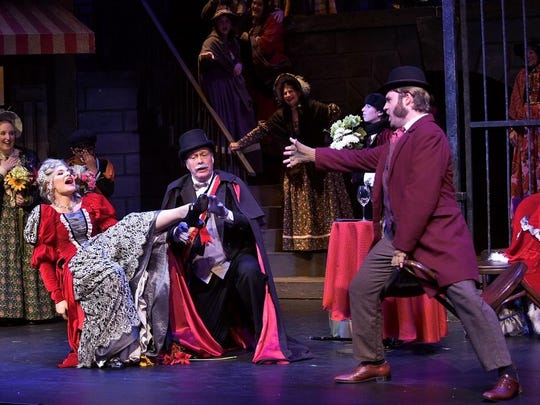 "Stacey Geyer (Musetta), Randy Messing (Alcindoro) and Scott Purcell (Marcello) star in the Tri-Cities Opera production of ""La Bohème."""
