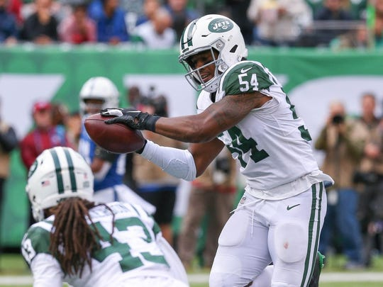 New York Jets inside linebacker Avery Williamson (54) intercepts a pass in front of cornerback Parry Nickerson (43) during the first half against the Indianapolis Colts at MetLife Stadium. (Vincent Carchietta-USA TODAY Sports)