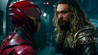 """This image released by Warner Bros. Pictures shows Ezra Miller, left, and Jason Momoa in a scene from """"Justice League."""" (Warner Bros. Entertainment Inc. via AP)"""