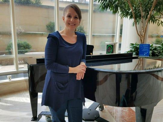 Sioux Falls teacher Katie Blunck poses near a piano