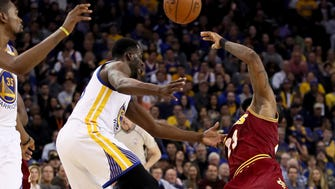 OAKLAND, CA - JANUARY 16:  Draymond Green #23 of the Golden State Warriors fouls LeBron James #23 of the Cleveland Cavaliers at ORACLE Arena on January 16, 2017 in Oakland, California. NOTE TO USER: User expressly acknowledges and agrees that, by downloading and or using this photograph, User is consenting to the terms and conditions of the Getty Images License Agreement.  (Photo by Ezra Shaw/Getty Images) ORG XMIT: 662354715 ORIG FILE ID: 631850156