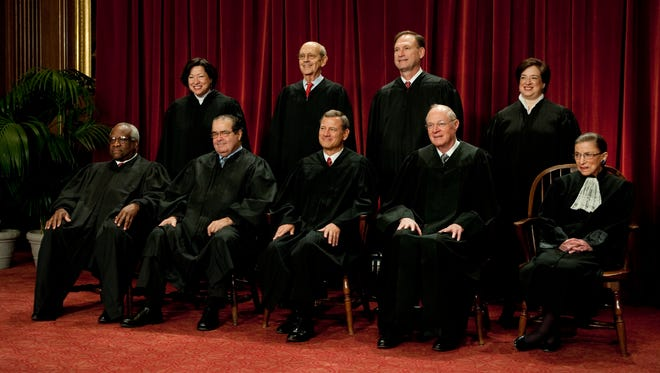 The Supreme Court sits for an official portrait in 2010 after Justice Elena Kagan, top right, became the newest member.