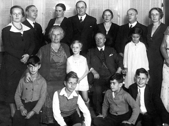 The Weisskopf family circa 1933, one of  the last times they were together. Fritz and Emmy Grunewald are in the back row on the right. Lore Grunewald  stands on the left.  Ida Weisskopf and Leopold Weisskopf flank granddaughter Margot Grunewald, middle row left.  Klaus Grunewald sits in front of Margot.