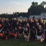 The Glen Este and Withrow soccer teams get together Sept. 1. The Lady Trojans donated new and gently-used shoes to the Withrow girls program in cooperation with Cincy Kids For Kids.