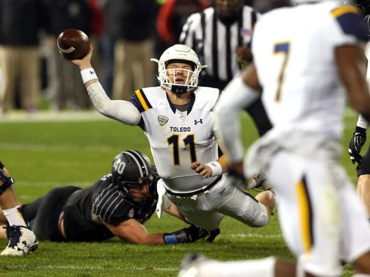 Toledo quarterback Logan Woodside (11) is sacked by Northern Illinois  linebacker Sean Folliard during the first half of an NCAA college football game in Chicago, on Wednesday, Nov 9, 2016. (Nuccio DiNuzzo/Chicago Tribune via AP)