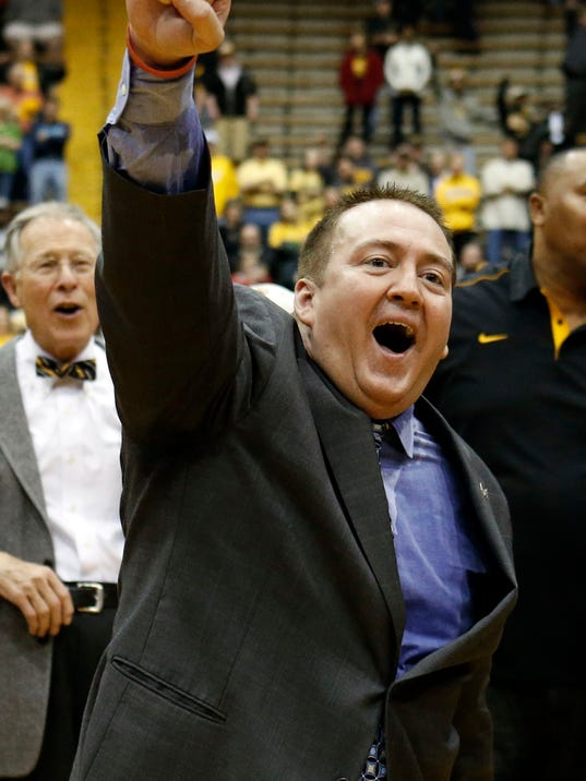 FILE - In this March 25, 2013 file photo, Southern Mississippi basketball coach Donnie Tyndall celebrates his team's 63-52 win over Louisiana Tech in their NIT college basketball game in Hattiesburg, Miss. Tennessee is counting on Tyndall to make the same successful transition from the mid-major ranks as the Volunteers' last two men's basketball coaches. Tennessee announced Tuesday morning, April 22, 2014, that Tyndall would be introduced as its new coach at a 2 p.m. news conference.  (AP Photo/Rogelio V. Solis, File)