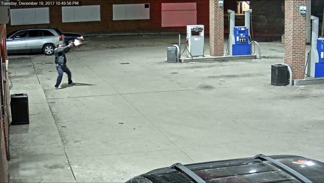 A screen grab from a video of a gas station shooting on Detroit's west side.