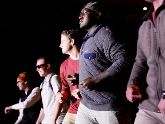 Loyola seniors Brophy Somerford (third from far left) and Savon Gipson  are serious models at style show.