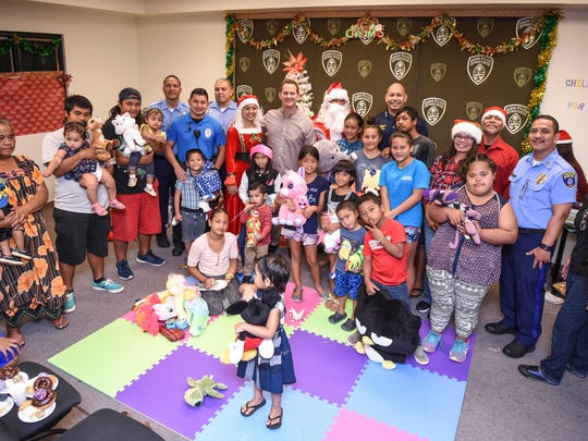 Officers of the Guam Police Department's Dededo Precinct invited underprivileged families to spend part of their hoilday season with them during the Children Smile for Hope Christmas event on Saturday, Dec. 23, 2017. During the event, children recieved gifts and other goodies donated or collected by the Chasing Rainbows End Organization, Children's Smiles Program, GPD's Mandaña Drug Task Force and other supporters.