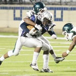 Mansfield's D'Andre Bailey tries to get past Huntington's defense Thursday evening at Independence Stadium.