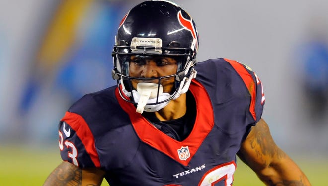 Texans running back Arian Foster runs for a short gain against the Chargers at Qualcomm Stadium.