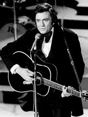 Johnny Cash performs at the Grand Ole Opry House on