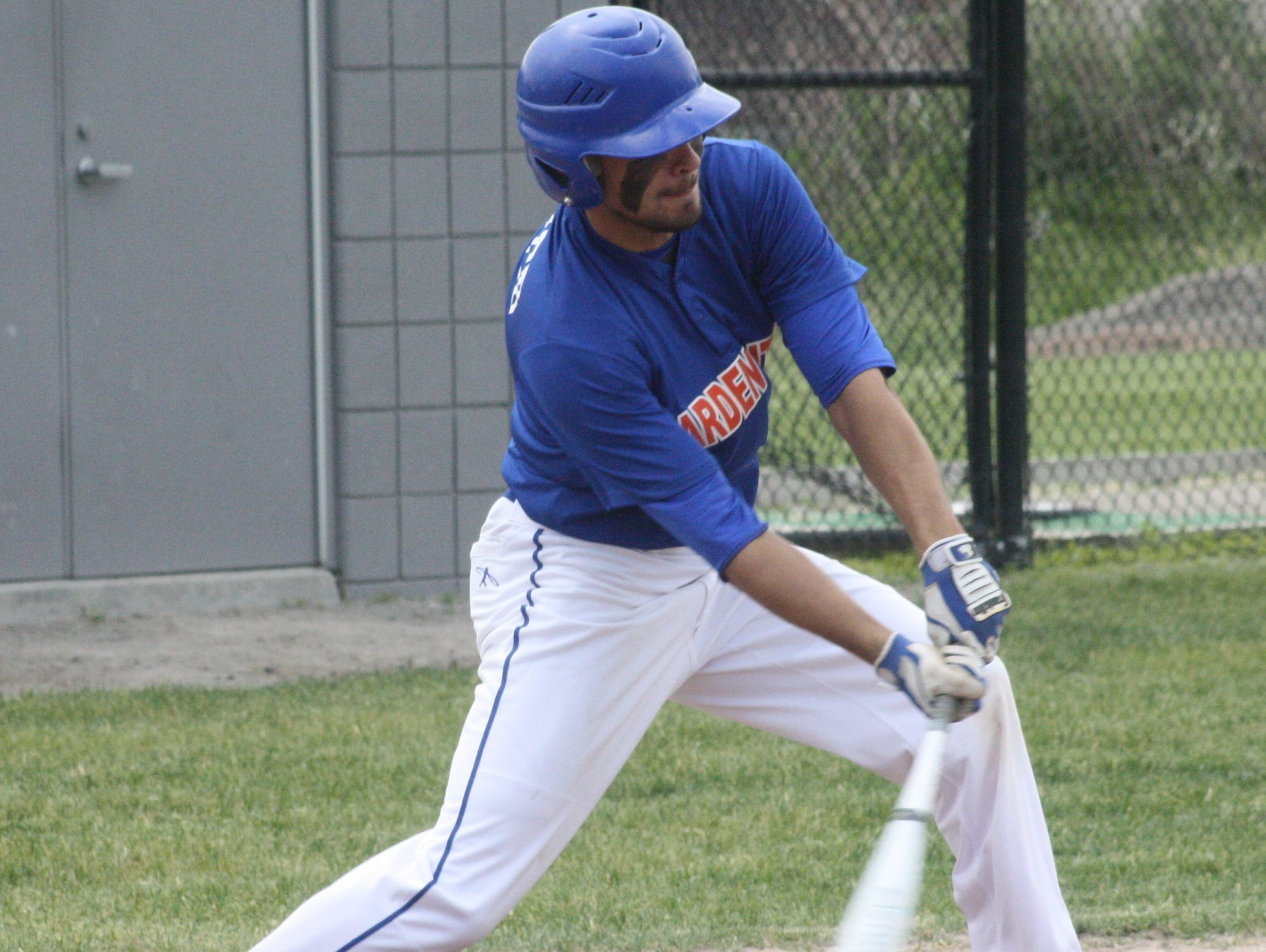 Garden City's Matt Kindred gets his bat on a low pitch Saturday morning.