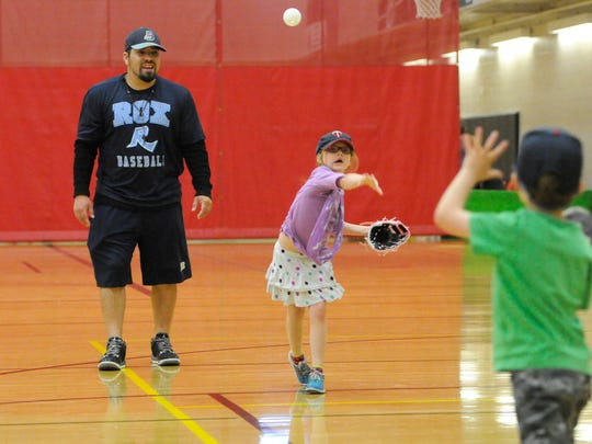 "St. Cloud Rox manager Augie Rodriguez gives some throwing advice during a clinic for Big Brothers Big Sisters of Central Minnesota at the Whitney Center in St. Cloud Saturday. The clinic is part of Big Brothers Big Sisters' new ""Sports Buddies"" initiative."