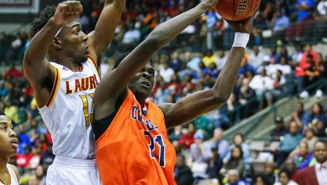 Callaway's Wesley Harris (21) shoots against Laurel during MHSAA Boys State Basketball Tournament semifinal action held in Jackson at the Mississippi Coliseum.