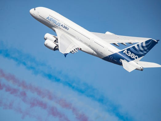 An Airbus A380 flies during a flight demonstration