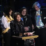 Inductees Alice Cooper, Dennis Dunaway, Michael Bruce and Neal Smith of Alice Cooper Band pose with a snake and accept their award onstage at the 26th annual Rock and Roll Hall of Fame Induction Ceremony at The Waldorf-Astoria on March 14, 2011 in New York City.