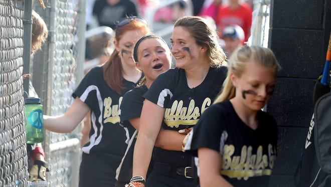 Buffalo Gap's Courteney Back is congratulated by a teammate as she enters the dugout after having hit a grand slam home run in the fifth inning. Buffalo Gap defeated Madison County 11-7 during a Region 2A East Tournament quarterfinals softball game in Buffalo Gap on Monday, June 1, 2015.