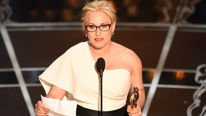 Patricia Arquette wins best supporting actress for 'Boyhood' at the 87th Academy Awards.