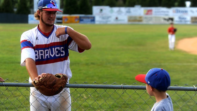 Ethan Carper, 6, talks with his favorite Staunton Braves player this year, Garrett Marchand, before the start of Wednesday's game.