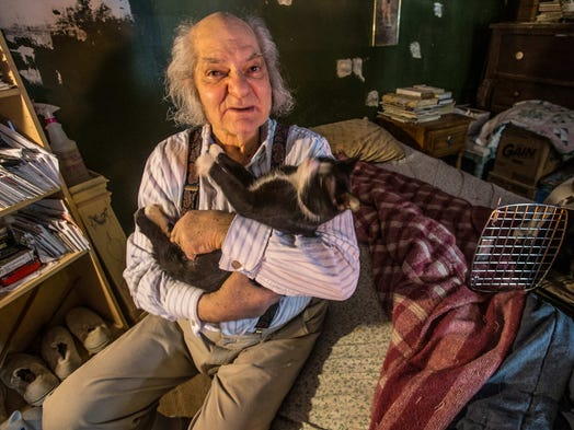 Charles Chulchian, 82, holds one of his more that 15 cats. Chulchian showed adult films at the Rivoli Theater from 1975-1992 when he was forced to close by the city.