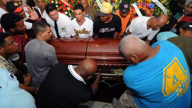 Relatives and supporters attend the funeral of Dominican baseball player Oscar Taveras at Puerto Plata, Dominican Republic, on Tuesday, Oct. 27, 2014.