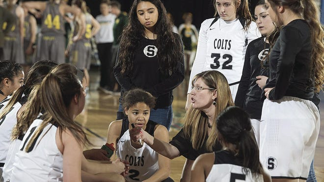 <p>South coach Shannan Lane, center, talks to the team during a timeout during the playoff game against Pueblo County on Feb. 23, 2018 at the Events Center in Pueblo, Colo. (Chris McLean, The Pueblo Chieftain)</p>