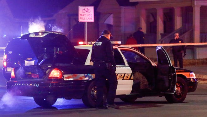 """Wichita police investigate a call of a possible hostage situation near the corner of McCormick and Seneca in Wichita, Kan., Thursday night. A man was fatally shot by a police officer in what is believed to be a gaming prank called """"swatting."""""""