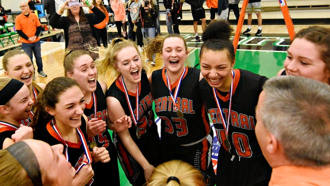 The Central York Panthers celebrate after beating Dallastown on Friday night, 40-19, in the York-Adams League girls' basketball title game. The Panthers are the No. 3 seed in the upcoming District 3 Class 6-A playoffs. DAWN J. SAGERT PHOTO