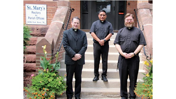 Priest now serving St. Mary's Church in Sleepy Eye and the Divine Mercy Area Faith Community are, from left: Fr. Mark Steffl, Fr. Sam Perez, and Fr. Zachary Peterson. They share in the distinction of having served St. Mary's parish previously.