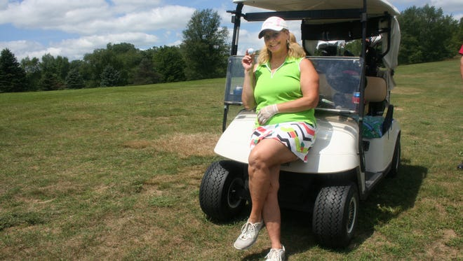 Candy Atkins of Pinckney made her second hole-in-one in the last 10 months on the 13th hole at Rush Lake Golf Course in Pinckney during the Turtle Bay Invitational on July 15, 2017.
